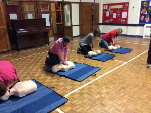 Parents practising CPR
