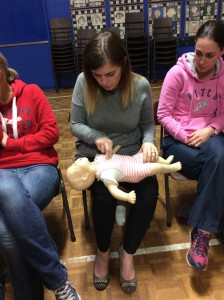 Parents learning life saving skills