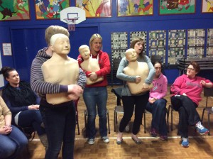 Life saving skills being practised during first aid training in school