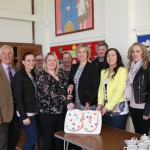 Staff & governors along with Sandra Overend cutting the 80th cake