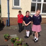 Stewartstown Community Group assisting with flowers funded by Housing Executive
