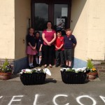 Assisting with flowers funded by Housing Executive
